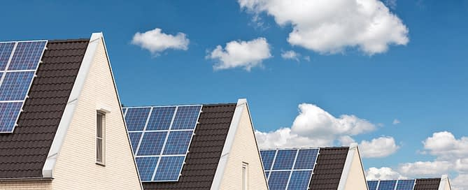 houses with solar panels as environmental upgrades